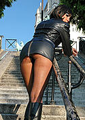 Stella in boots leather and black pantyhose