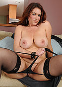 Busty MILF in lingerie and black stockings