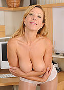 Blonde office lady shows off her pantyhose