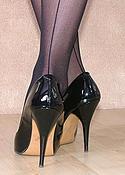 Leggy brunette black dress and nylon legs