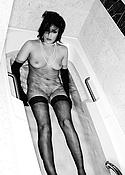 Sex brunette in tub with black stockings
