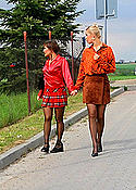 Two chicks outdoors in nylons fucking one guy