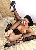 Sexy brunette babe in pantyhose and nylon top