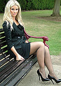 Blonde outdoors in black pantyhose and heels