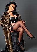 Danica Collins in fur coat and black stockings