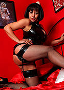 Danica Collins in latex and fishnet stockings