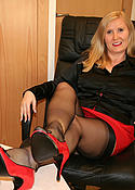Mature blonde lady shows stockings and heels