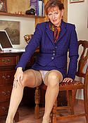 mature redhead in biz outfit and nude stockings