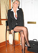 Busty blonde Lucy Zara in black pantyhose pics