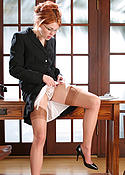 Cute secretary in stockings and pumps