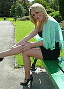 Cute blonde outdoors in heels and stockings