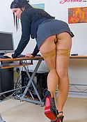 Busty secretary in nude stockings