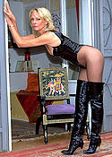 Mature blonde babe in pantyhose and boots